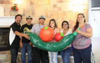 From left, Andrew Barraza, lead mentor for CenCal Mentoring Academy, Jesse Gutierrez, Juan Adame, Samantha Everson, Elesly Hernandez, and Cynthia Sandoval, hold pieces of their harvest display.